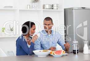 Smiling couple having breakfast together