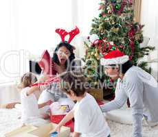 Happy family opening Christmas presents