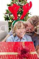 Loving mother kisses son at Christmas