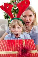 Portrait of a surprised mother and son at Christmas time