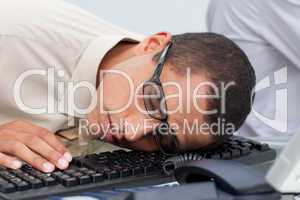Young businessman sleeping on the keyboard