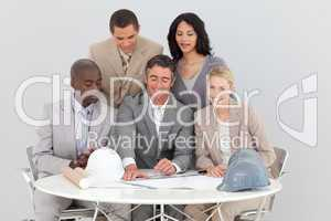 Architectural business people studying plans