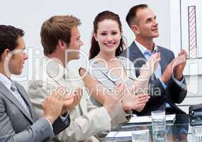 Attractive businesswoman applauding in a meeting