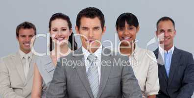 Positive multi-ethnic business team in front of the camera