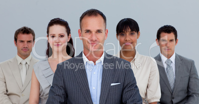 Multi-ethnic business team standing in front of the camera