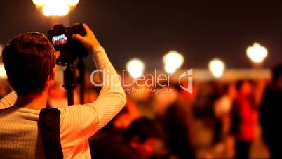 Photojournalist and Crowd of People