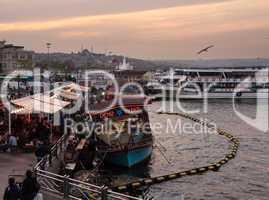 Restaurant boats by Galata bridge in Istanbul