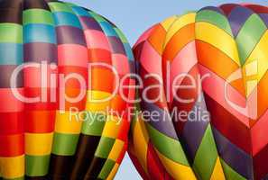 Two Hot air balloons bumping