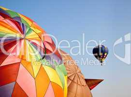 Hot air balloon in the air above two others