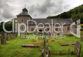 Cloudy sky overshadows Melangell Church in Wales