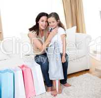 Happy mother and little girl after shopping