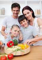 Portrait of  happy parents cooking with their children