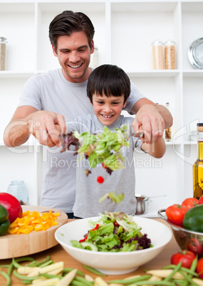 Little boy and his father cooking