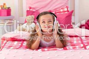 Cute girl listening music in the bedroom
