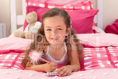 Cute girl lying on bed