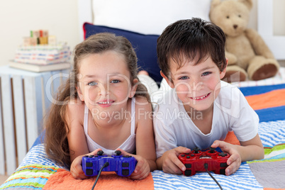 Siblings playing video games together