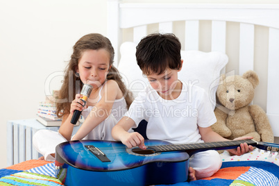 Siblings singing and playing guitar