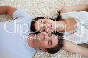 Couple sleeping on the floor