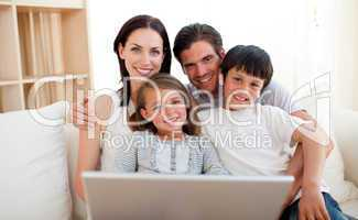 Happy family surfing the internet