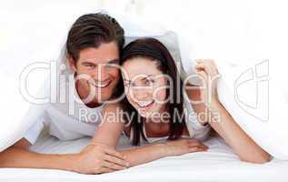 Happy Couple lying on bed