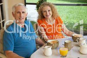 Senior Man and Woman Couple Enjoying a Healthy Breakfast