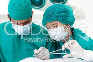 Portrait of two ethnic surgeons in operative room
