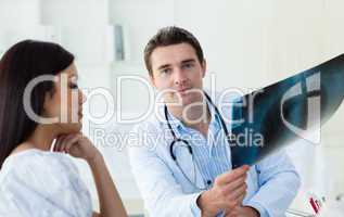 Confident doctors analyzing an x-ray