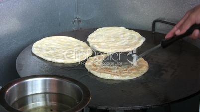 Frying Roti Bread