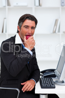 Smiling businessman eating an apple