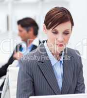 Concentrated businesswoman sitting at office desk