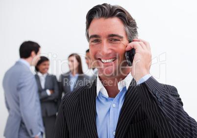 Portrait of smiling businessman on phone