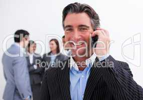 Portrait of smiling businessman on phone