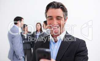 Confident businessman writing a text with a mobile phone