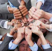 Multi-ethnic business people with thumbs up