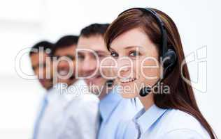 Business team with headset on working in a call center