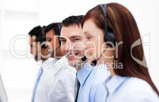 Multi-ethnic customer service agents in a call center