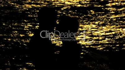 HD young couple kissing on the seashore