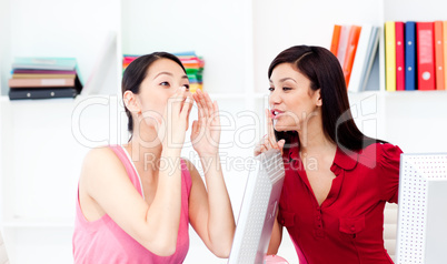 Businesswoman yelling and her colleague asking for silence