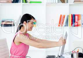 Attractive businesswoman getting frustrated with a computer