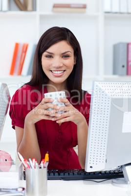 Beautiful businesswoman drinking a coffee