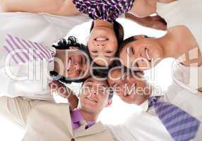 Smiling business team in a circle with heads together