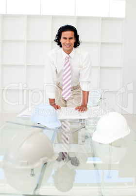 Attractive male engineer studying blueprints
