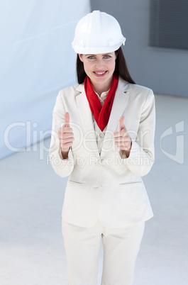 Beautiful female architect wearing a hard hat