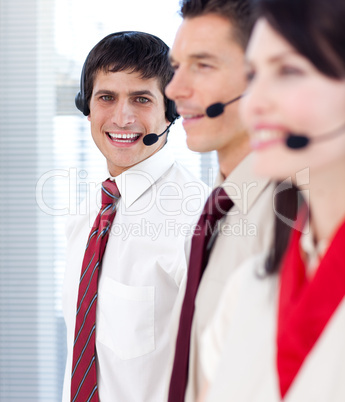 Businessman with headset on smiling at the camera