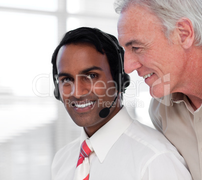 Multi-ethnic customer service agents working together
