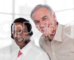 Senior businessman helping his colleague