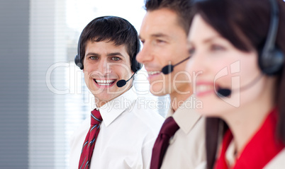 Young business people with headsets on