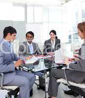 Business team studying a new business plan