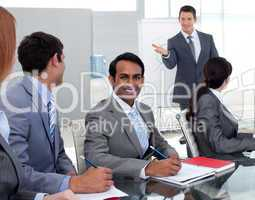 Young businesman studying a new business plan with his team