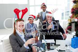 Multi-ethnic busioness team toasting with Champagne at a Christm